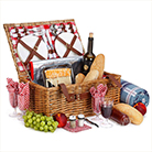 Cool birthday gifts - wicker basket filled with treats for a birthday picnic